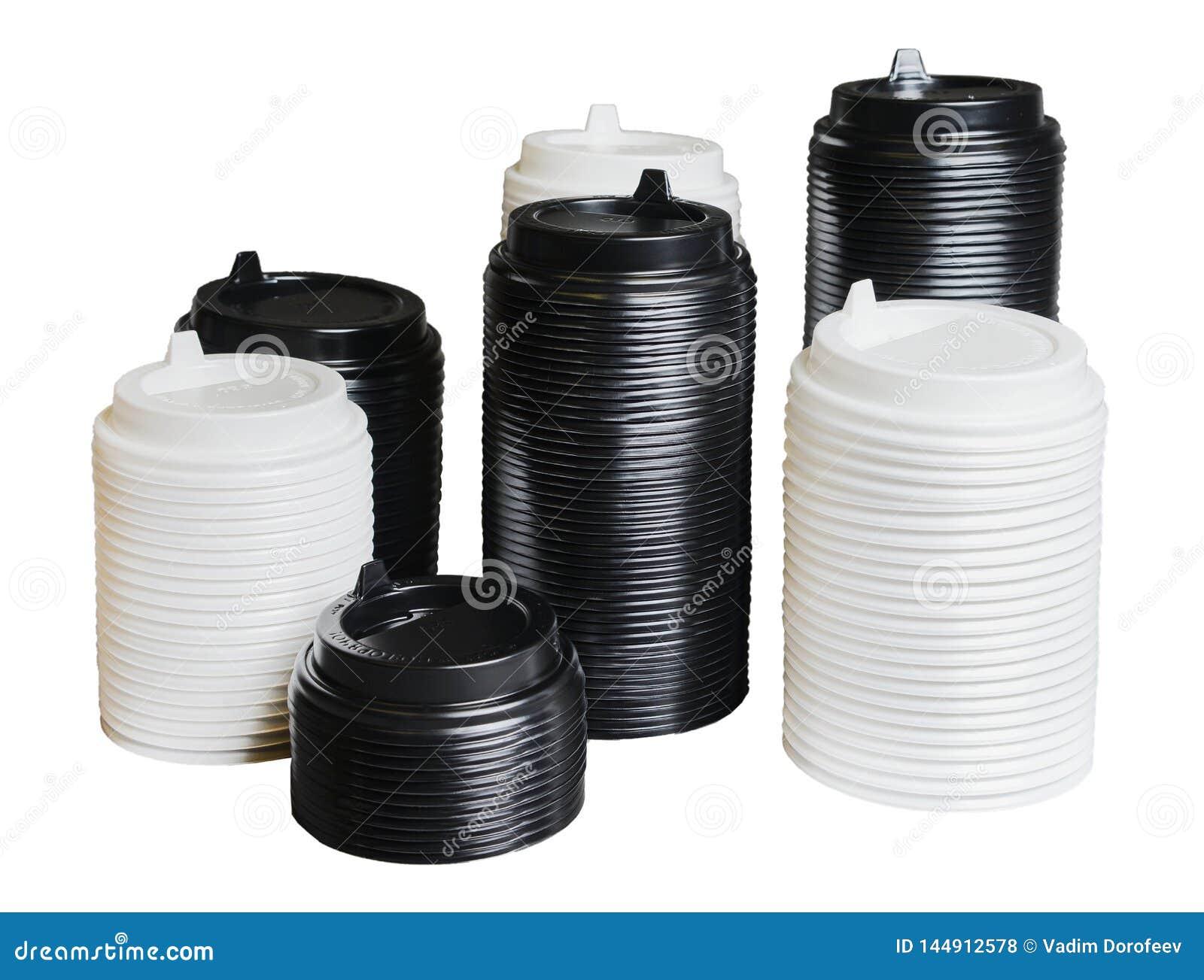 Διάφοροι σωροί των καλύψεων για τα μίας χρήσης φλυτζάνια των διαφορετικών μεγεθών Λευκό και ο Μαύρος Άσπρο απομονωμένο υπόβαθρο