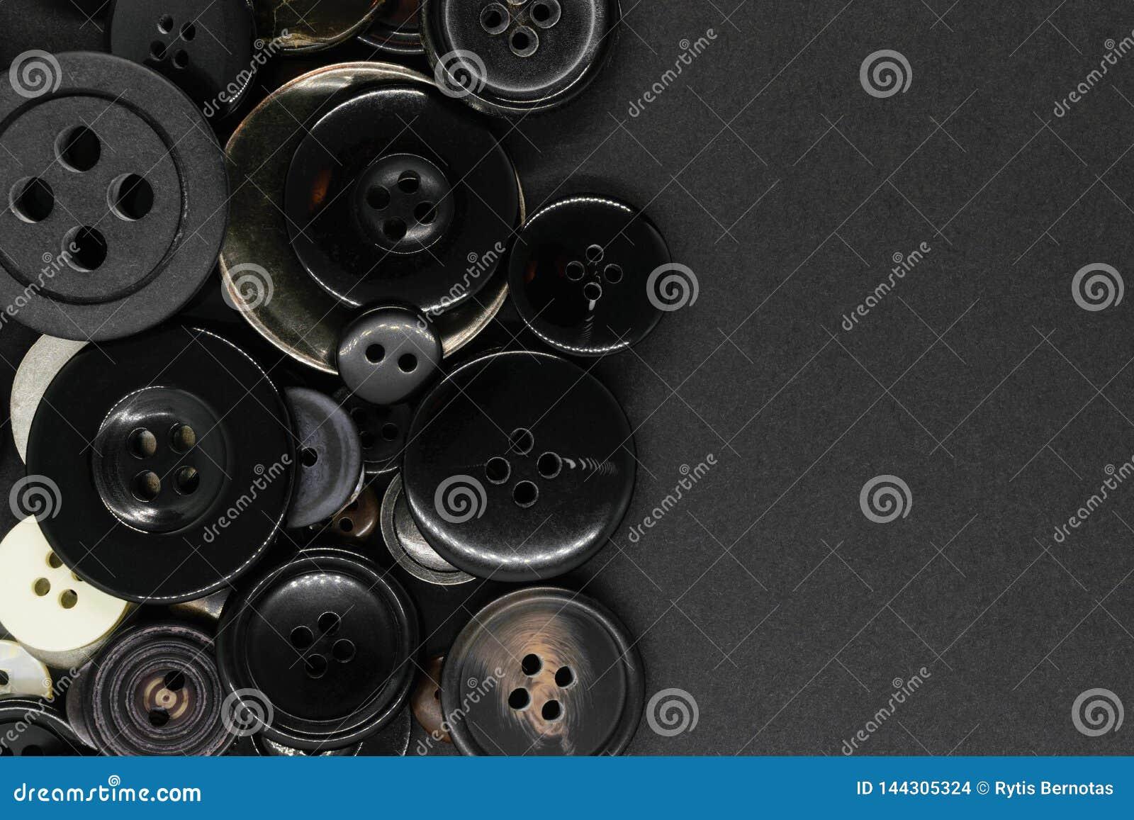 Διάφορο σκοτεινό υπόβαθρο κουμπιών ενδυμάτων