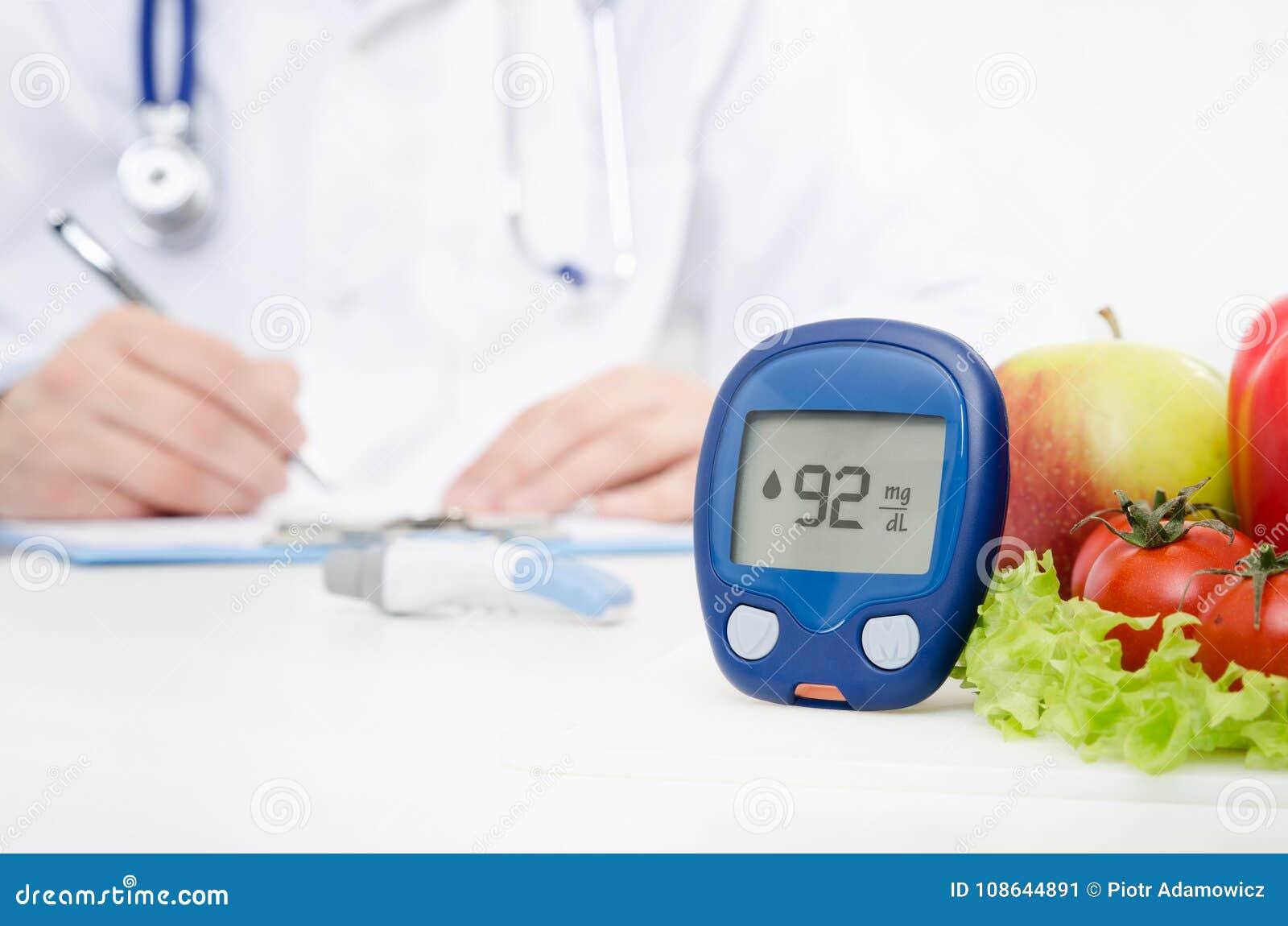 Διαβήτης στο γιατρό Glucometer και έννοια λαχανικών