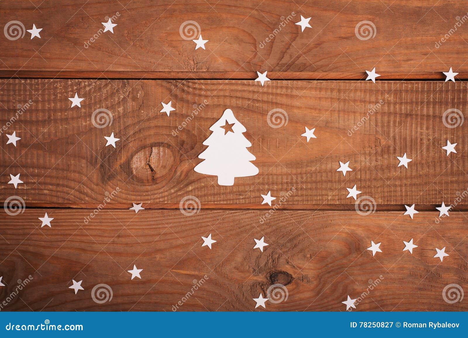 Διακοσμήσεις καρτών Χαρούμενα Χριστούγεννας στην κοπή εγγράφου πέρα από το woodeno