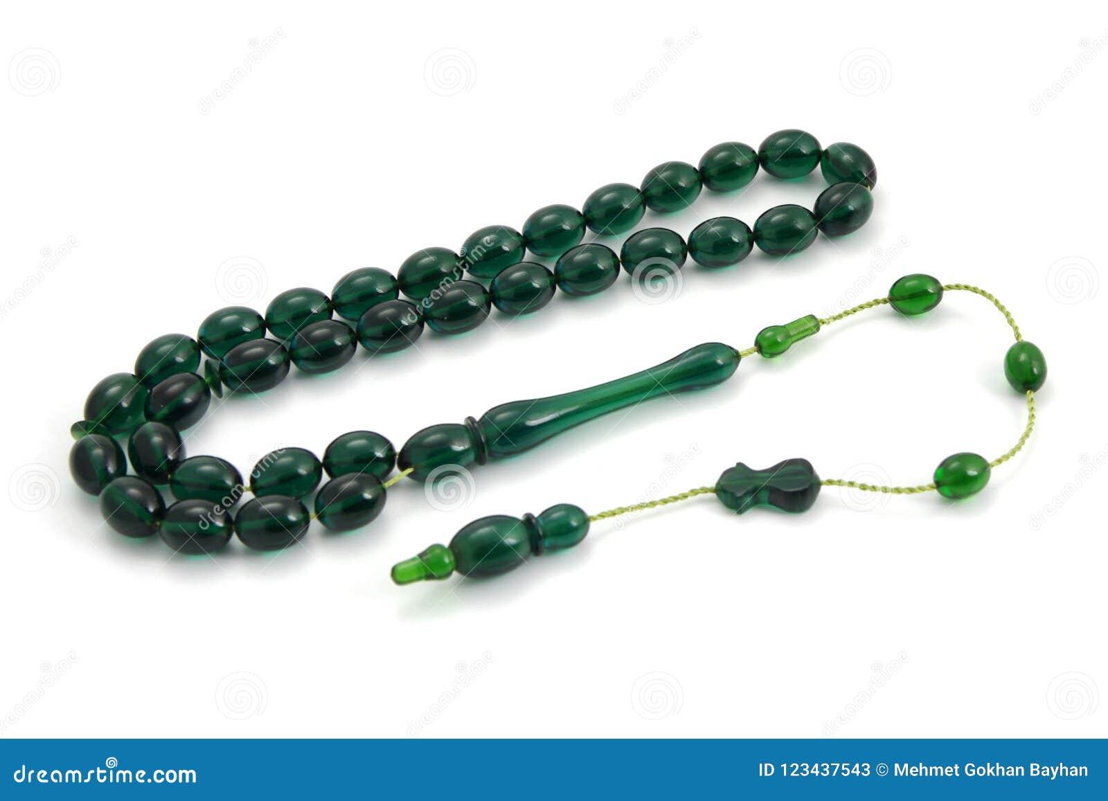 Διαφανής πράσινη πλαστική άποψη προοπτικής χαντρών προσευχής που απομονώνεται στο λευκό