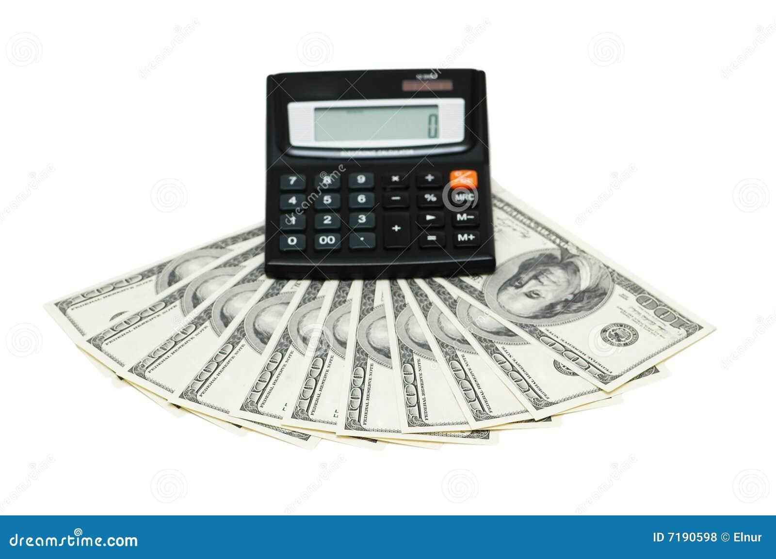 Δολάρια και υπολογιστής που απομονώνονται