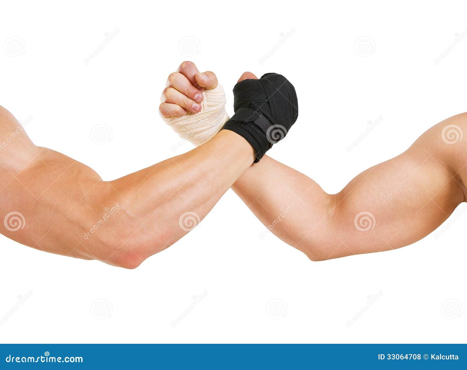Δύο χέρια ο βραχίονας παλεύοντας, η προσπάθεια γραπτού