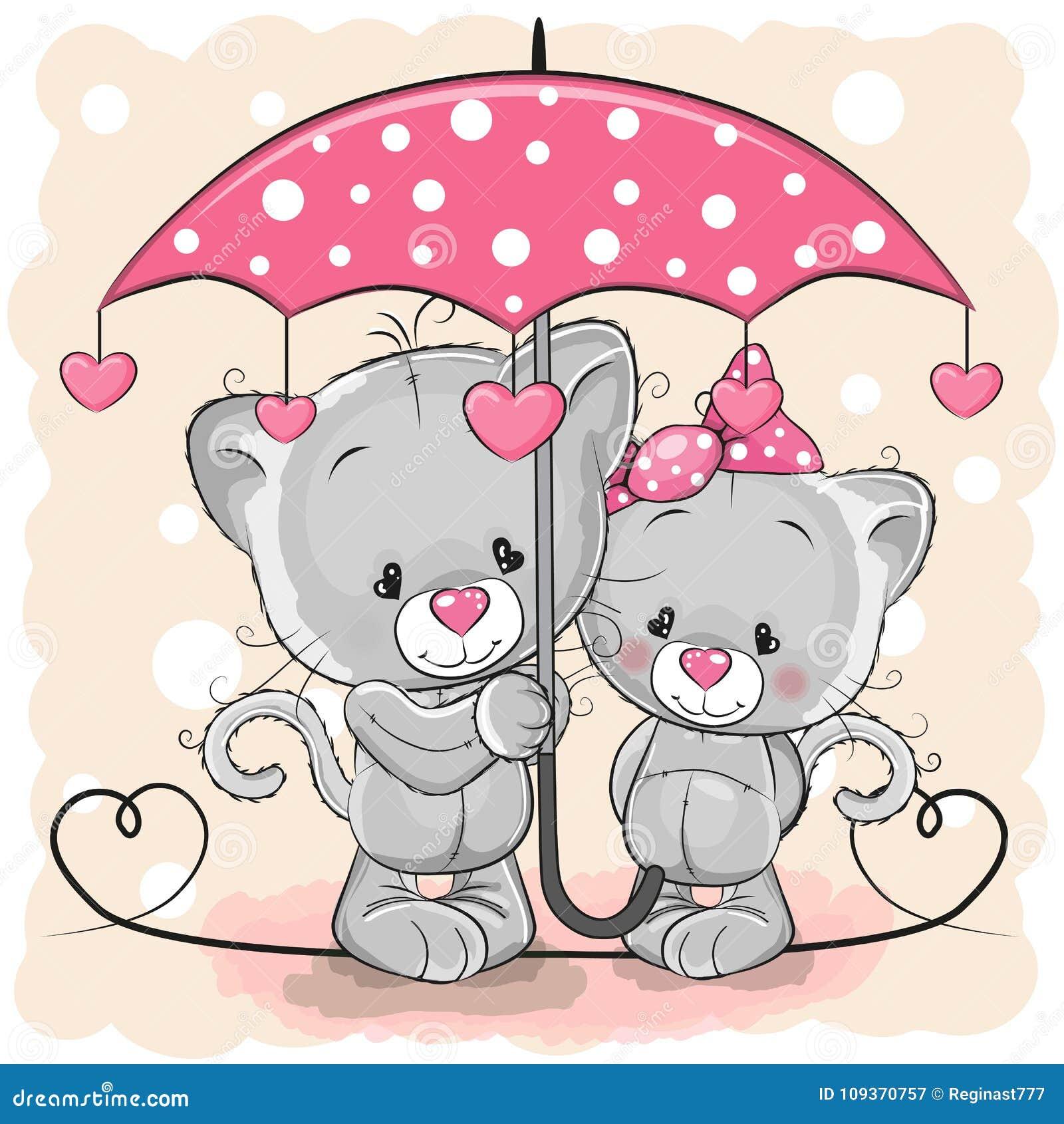 Δύο χαριτωμένα γατάκια με την ομπρέλα κάτω από τη βροχή