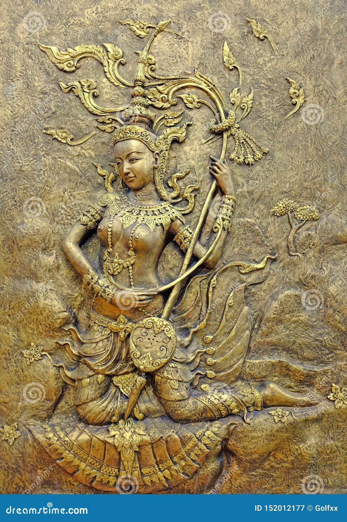 Εγγενές ταϊλανδικό γλυπτό πολιτισμού στον τοίχο ναών