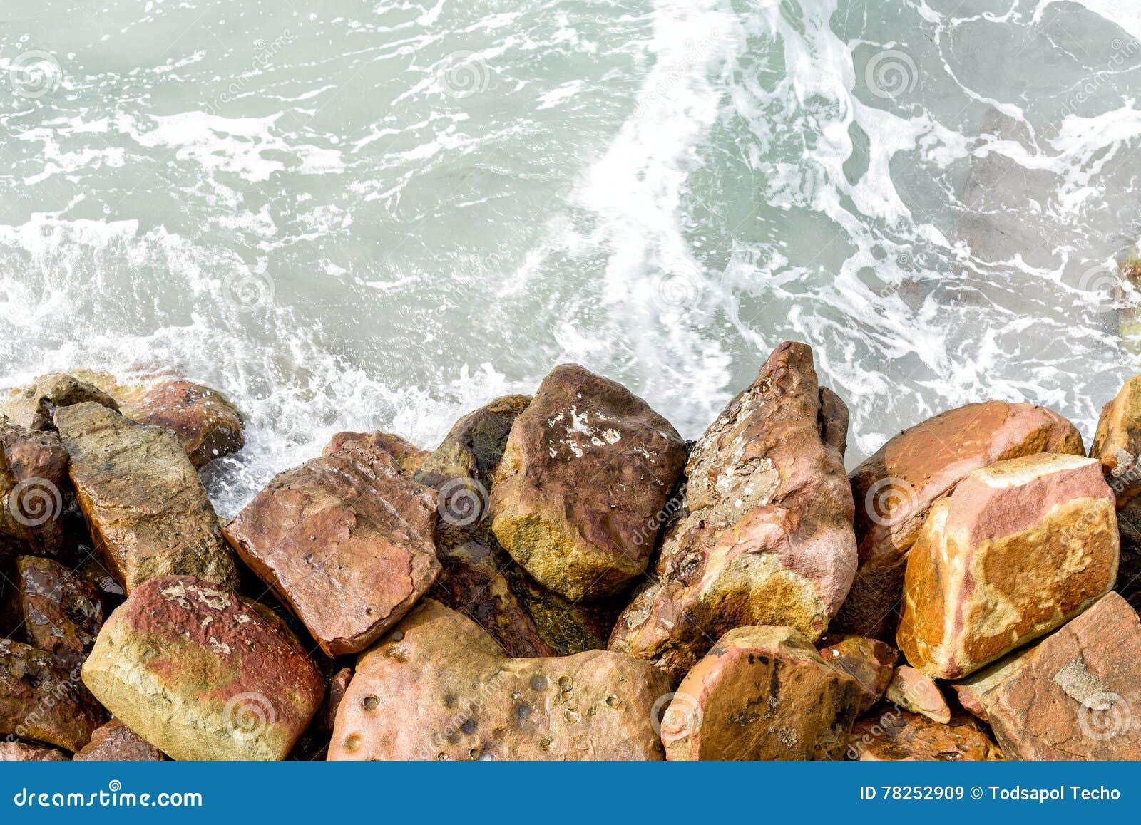 Επιφάνεια θαλάσσιου νερού και πέτρα/βράχος, υπόβαθρο/σύσταση