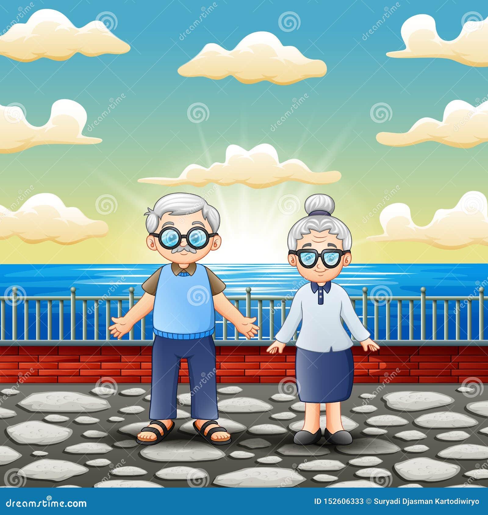 Ευτυχές παλαιό ζεύγος που στέκεται κοντά στη θάλασσα
