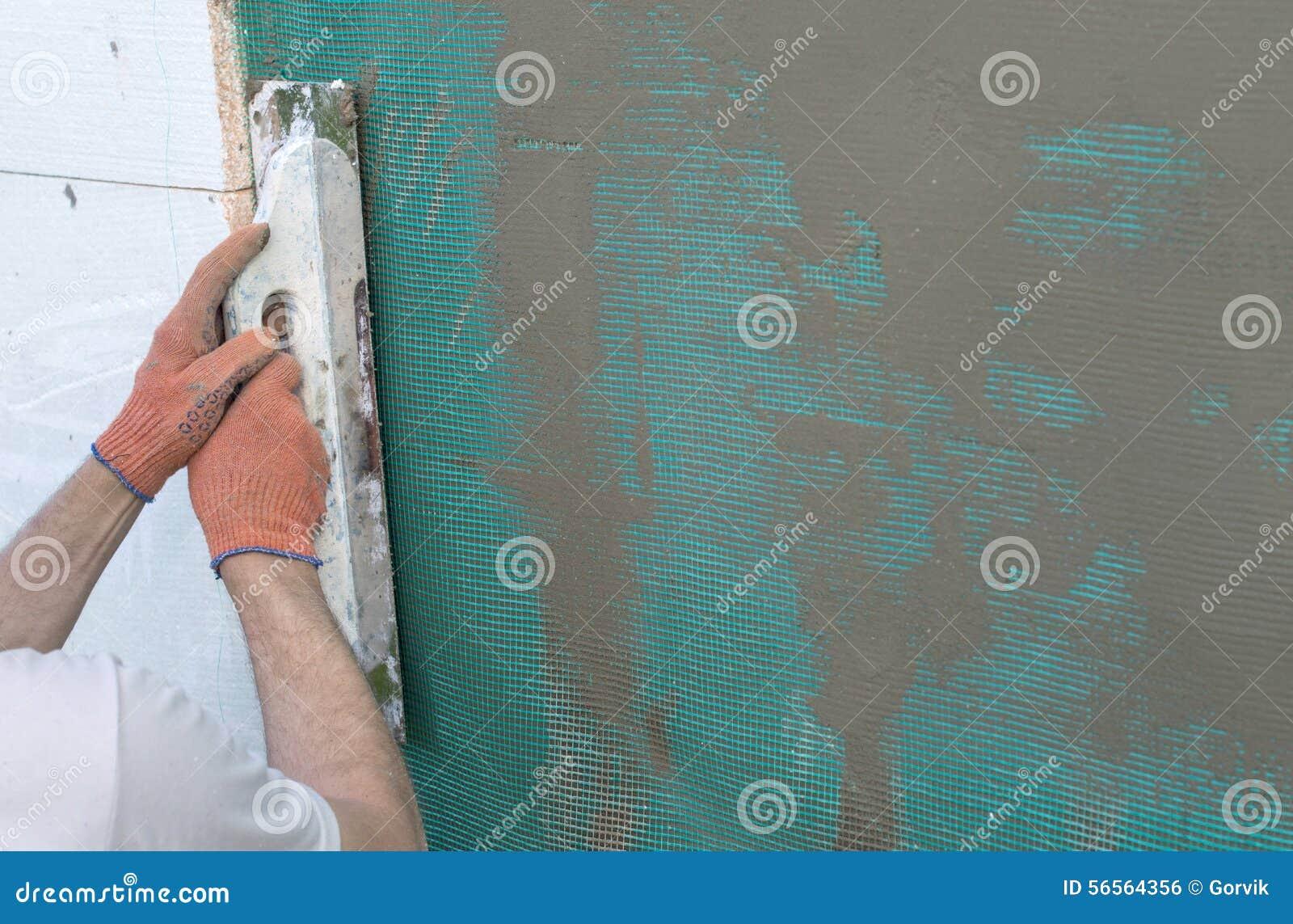 Download Εφαρμογή Putty στον τοίχο που χρησιμοποιεί Spatula Στοκ Εικόνες - εικόνα από putty, κόλλα: 56564356