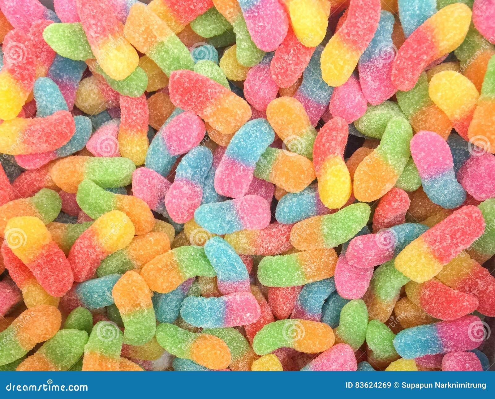 Ζωηρόχρωμη bonbon καραμελών ζελατίνας ομάδα πρόχειρων φαγητών γλυκό για το υπόβαθρο ημέρας βαλεντίνων χρώμα κρητιδογραφιών στο γα