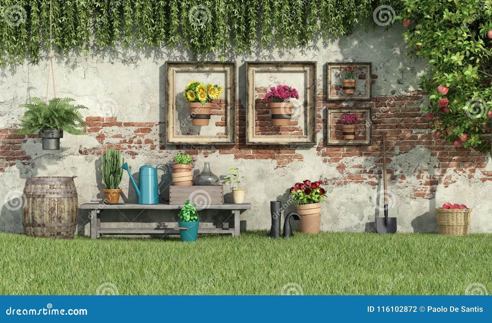Ηλιόλουστος κήπος με τα λουλούδια και τις εγκαταστάσεις