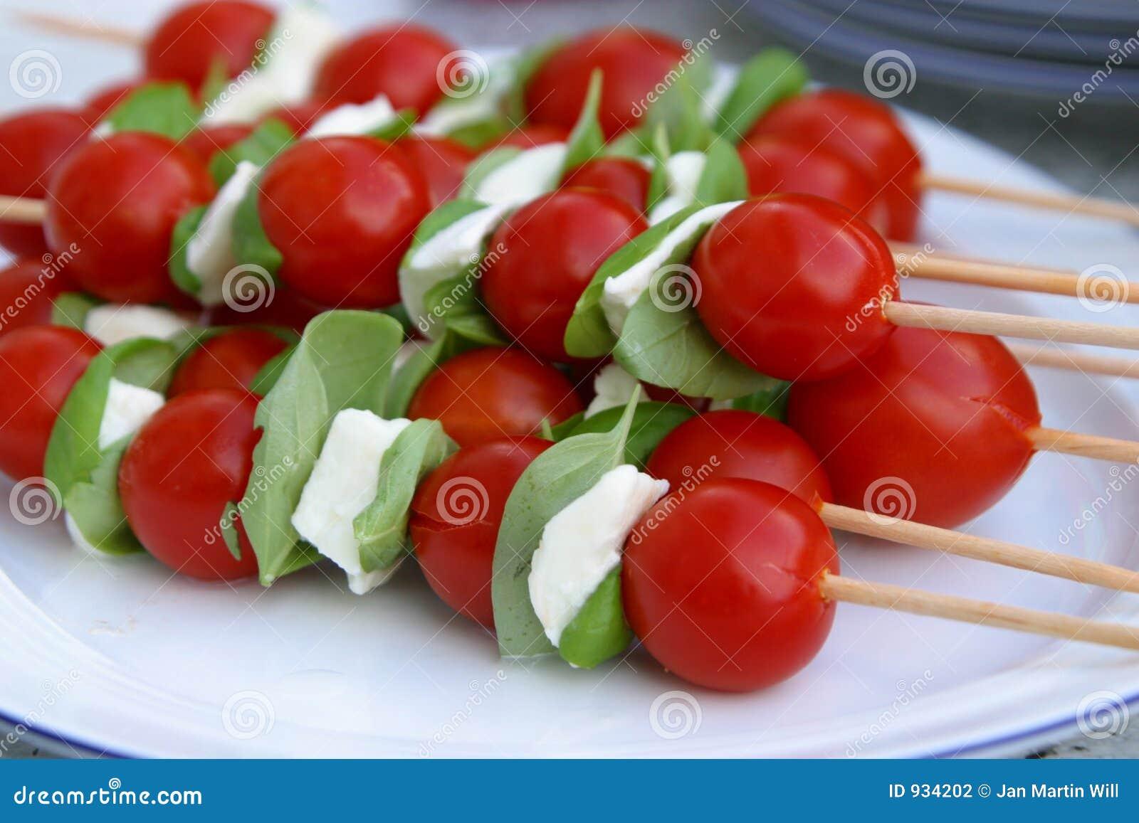 η μοτσαρέλα κολλά tomatoe