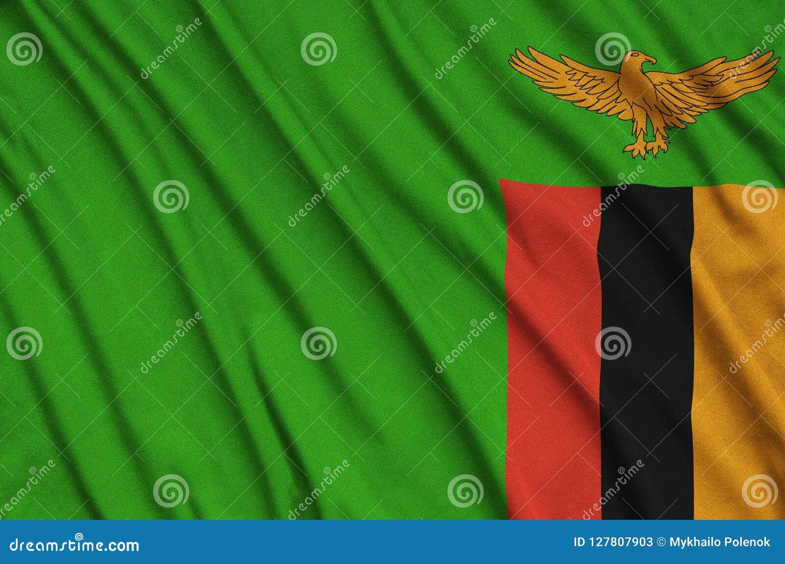 Η σημαία της Ζάμπια απεικονίζεται σε ένα ύφασμα αθλητικών υφασμάτων με πολλές πτυχές Έμβλημα αθλητικών ομάδων