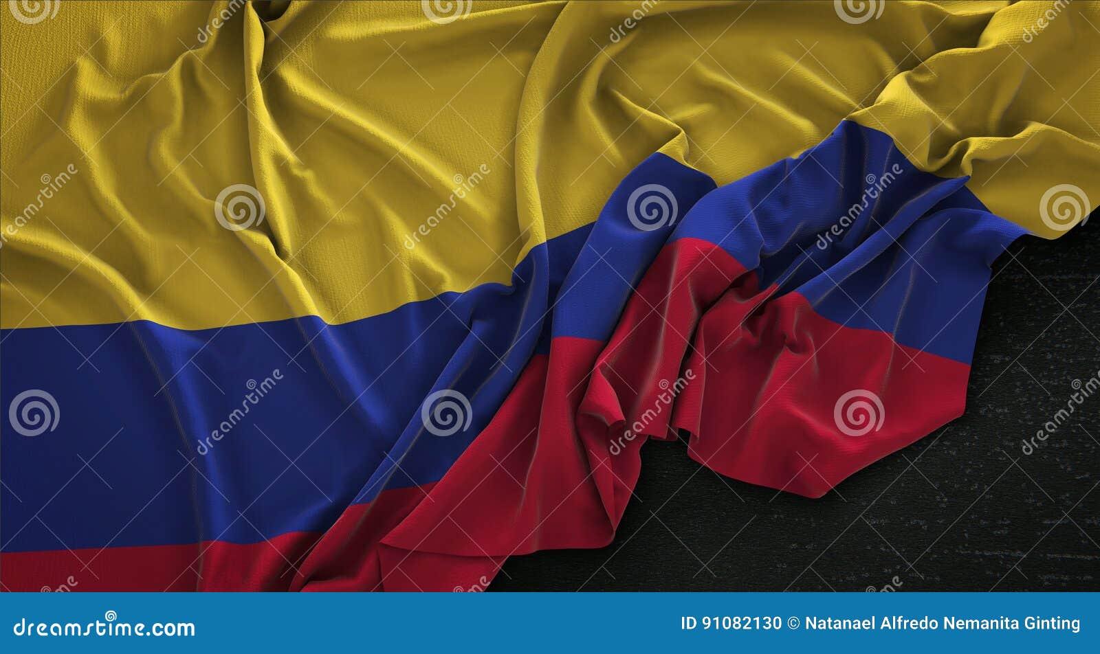 Η σημαία της Κολομβίας που ζαρώνεται στο σκοτεινό υπόβαθρο τρισδιάστατο δίνει