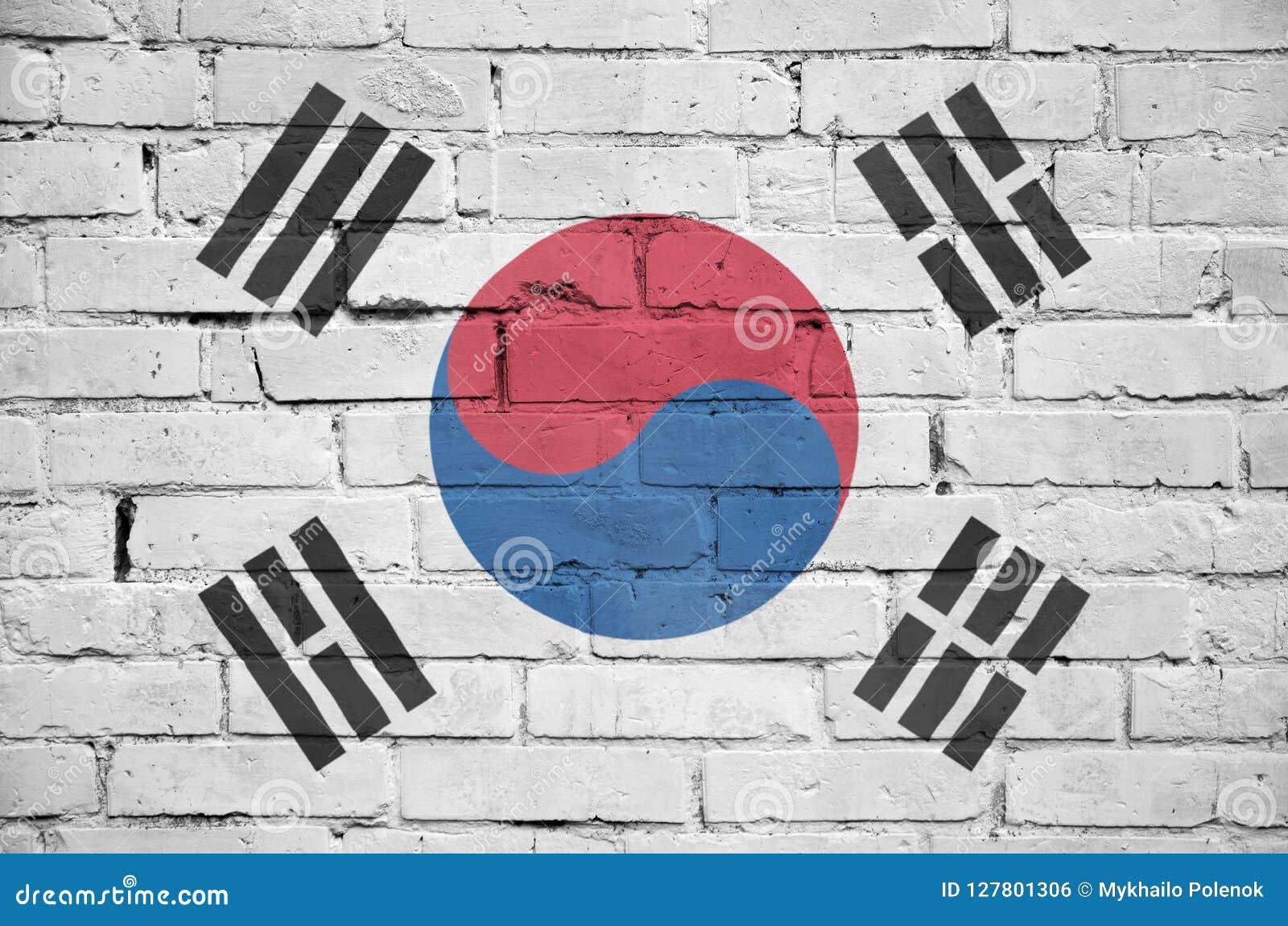 Η σημαία της Νότιας Κορέας είναι χρωματισμένη επάνω σε έναν παλαιό τουβλότοιχο