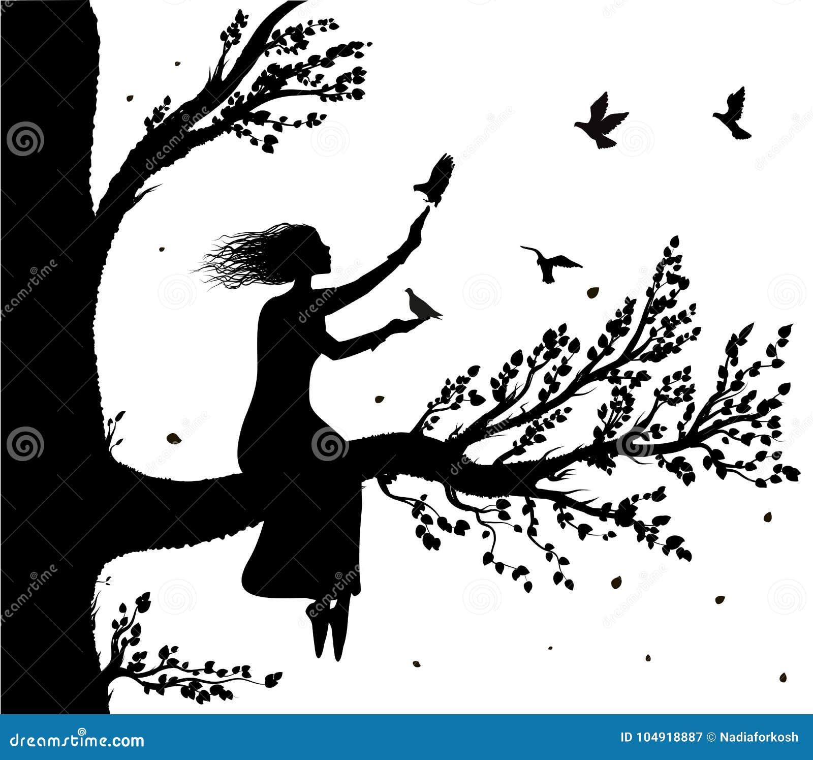 Η συνεδρίαση κοριτσιών στο μεγάλο δέντρο διακλαδίζεται μια εκμετάλλευση τα περιστέρια που πετούν σε την, τον αέρα φθινοπώρου και