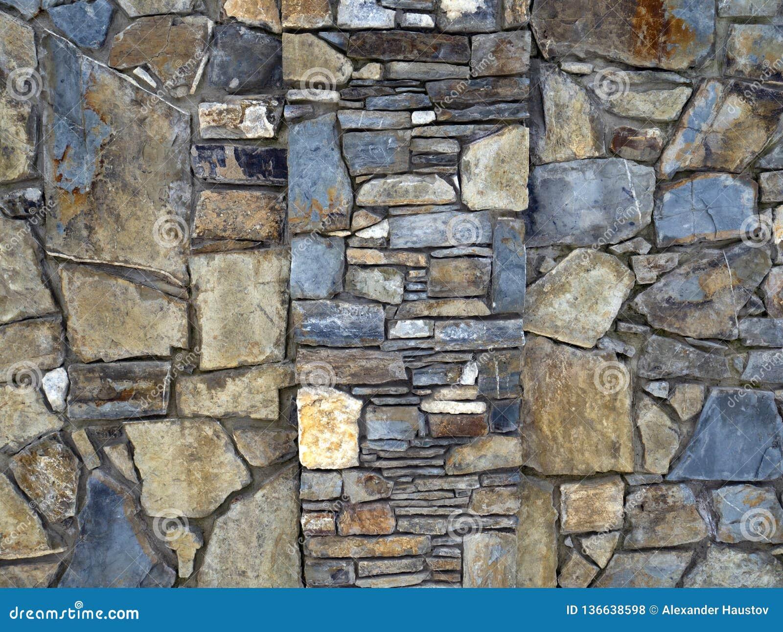 Η σύσταση του τοίχου που στρώνεται με την πέτρα