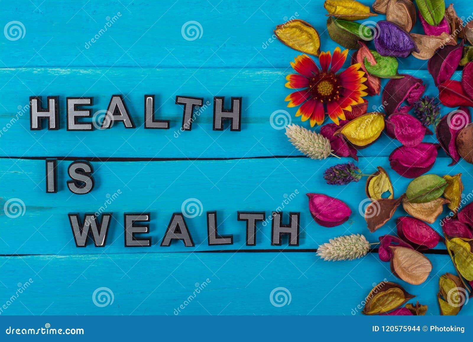 Η υγεία είναι κείμενο πλούτου στο μπλε ξύλο με το λουλούδι