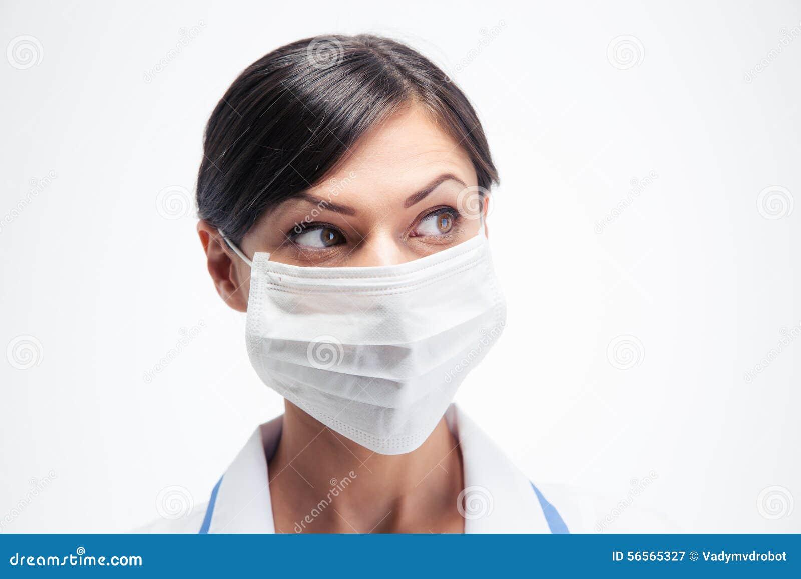 Download Θηλυκός ιατρός στη μάσκα που κοιτάζει μακριά Στοκ Εικόνα - εικόνα από εγγράφων, επαγγελματίας: 56565327