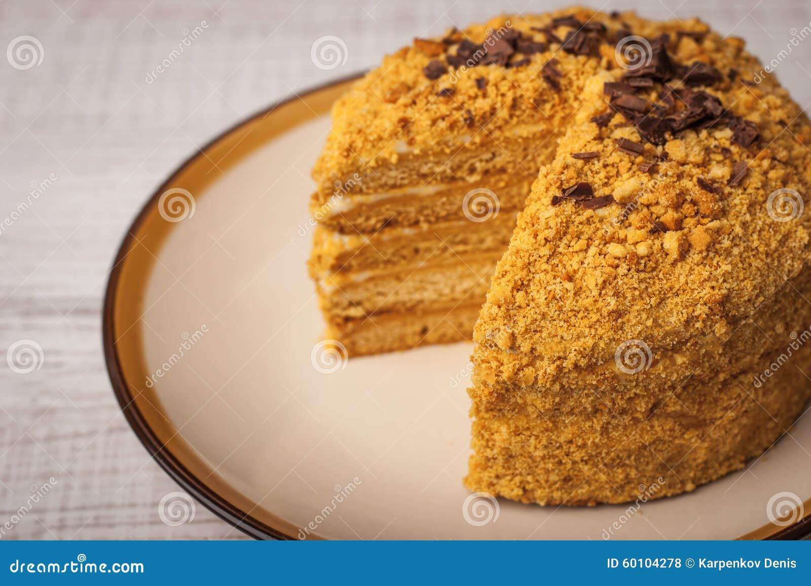 Κέικ μελιού με τα τσιπ σοκολάτας και φέτα που αποκόπτει