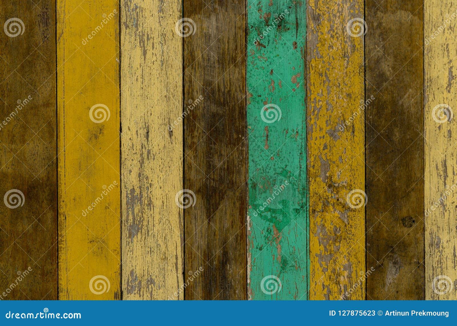 Κίτρινο, πράσινο, και καφετί ξύλινο υπόβαθρο σύστασης τοίχων Παλαιό ξύλινο πάτωμα με το ραγισμένο χρώμα χρώματος Εκλεκτής ποιότητ