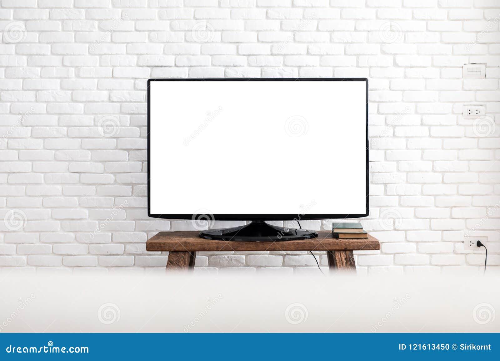 Κενή άσπρη επίπεδη ένωση οθόνης TV σε έναν άσπρο τοίχο