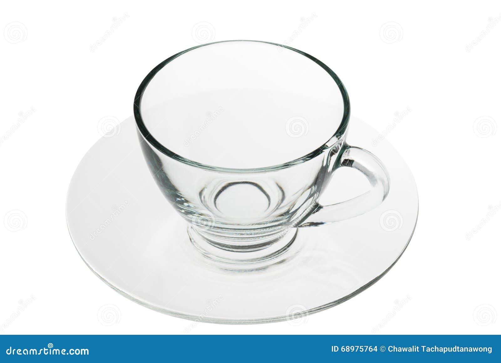 Κενό γυαλί καφέ με το πιάτο που απομονώνεται