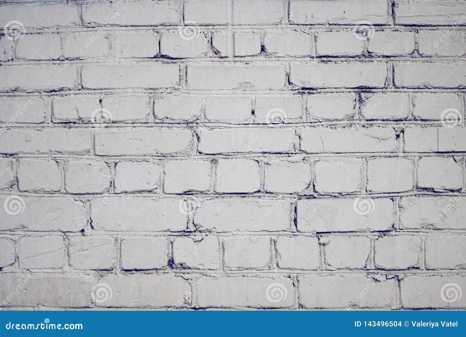 Κενό υπόβαθρο με την επιφάνεια τούβλου, που χρωματίζεται με το άσπρο χρώμα