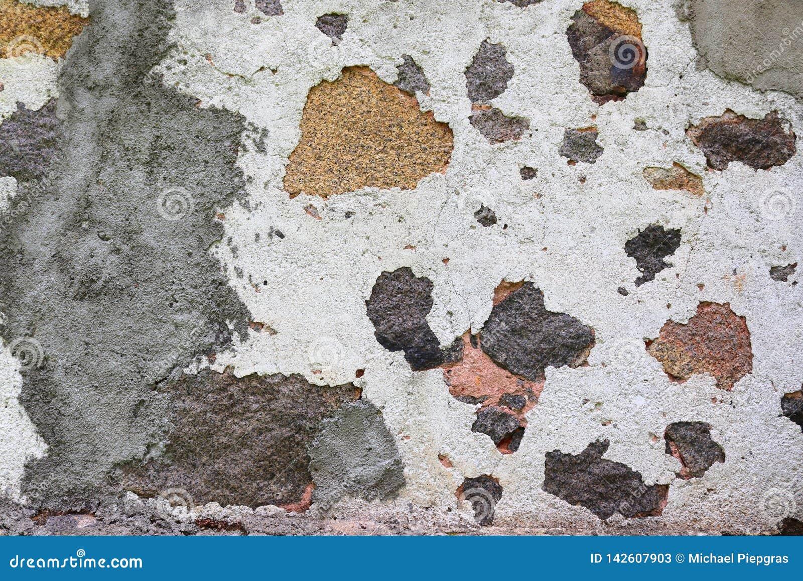 Κλείστε επάνω την επιφάνεια υψηλής ανάλυσης του ηλικίας και ξεπερασμένου χρώματος σε έναν τοίχο