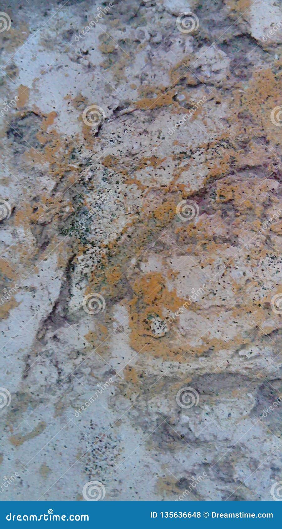 Κομμένη επιφάνεια πετρών Άσπρος-πορτοκαλιά επιφάνεια πετρών