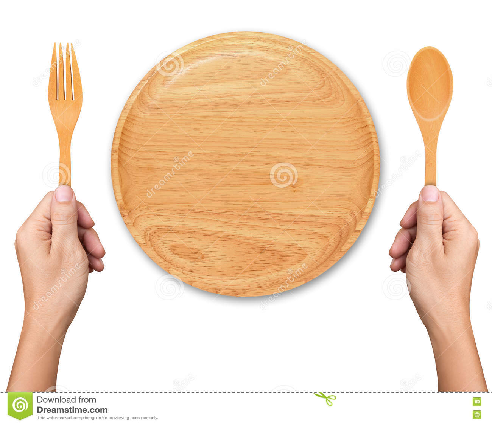 Κουτάλι και δίκρανο λαβής χεριών με το κενό ξύλινο πιάτο στο λευκό