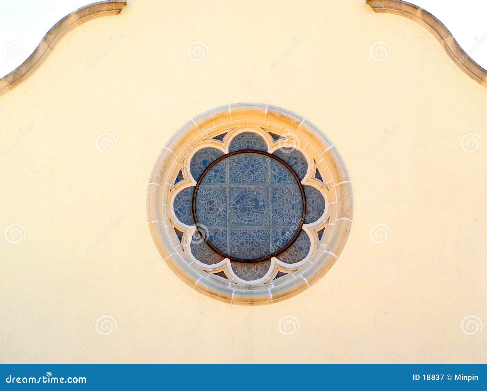 κυκλικό λεκιασμένο γυαλί παράθυρο