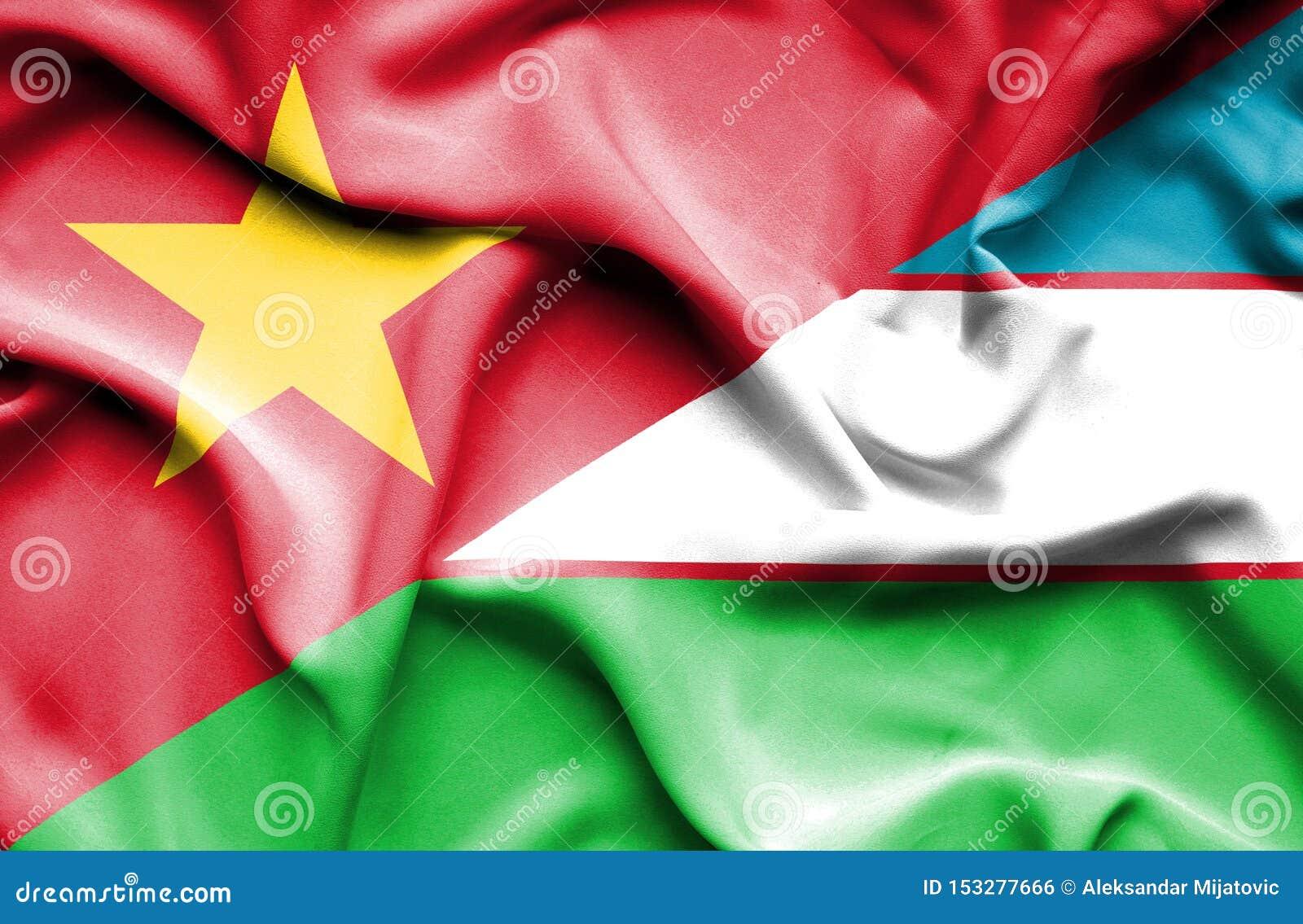 Κυματίζοντας σημαία του Ουζμπεκιστάν και του Βιετνάμ