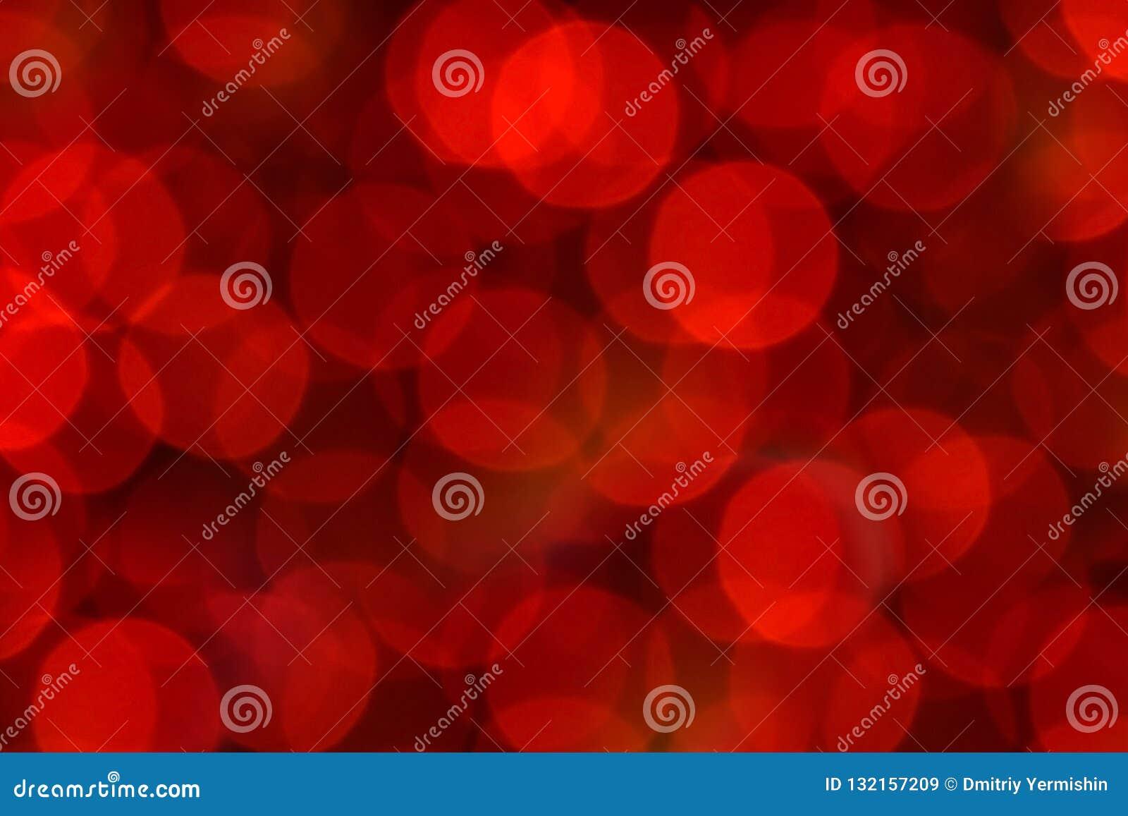 Κόκκινα Χριστούγεννα bokeh με τα ελαφριά υπέροχα μικρά φω τα