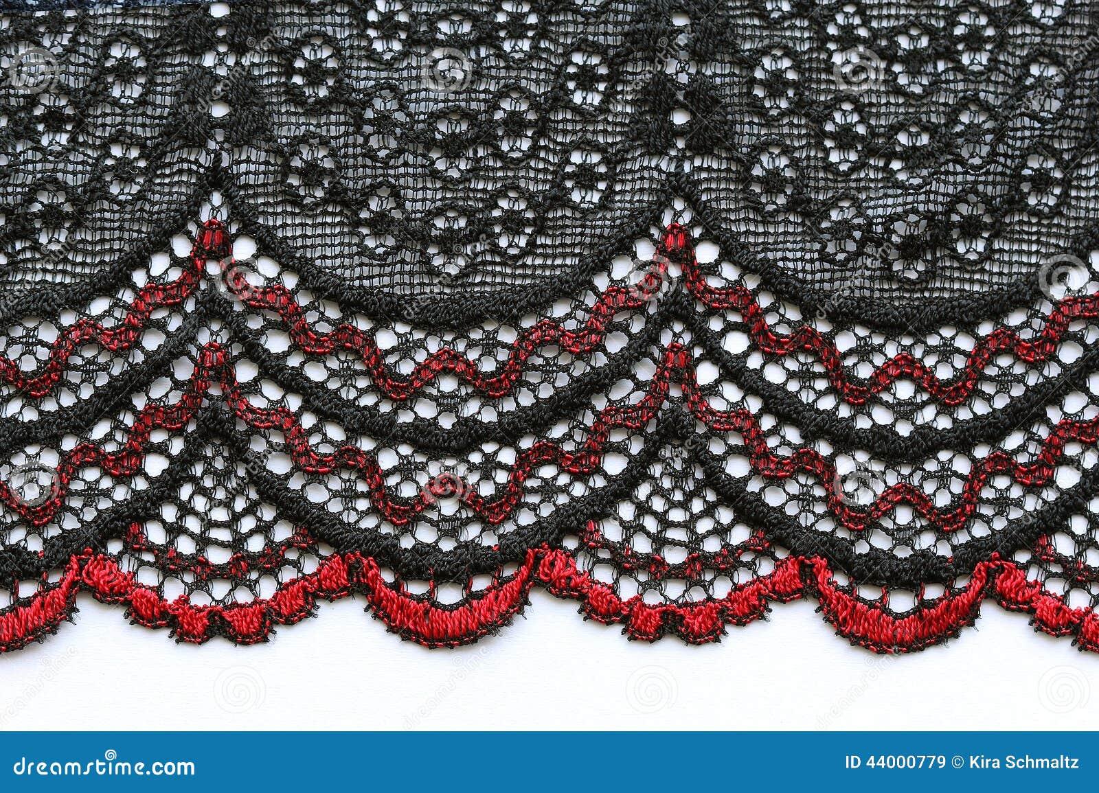 Κόκκινος και μαύρος λουλουδιών μακρο πυροβολισμός σύστασης δαντελλών υλικός