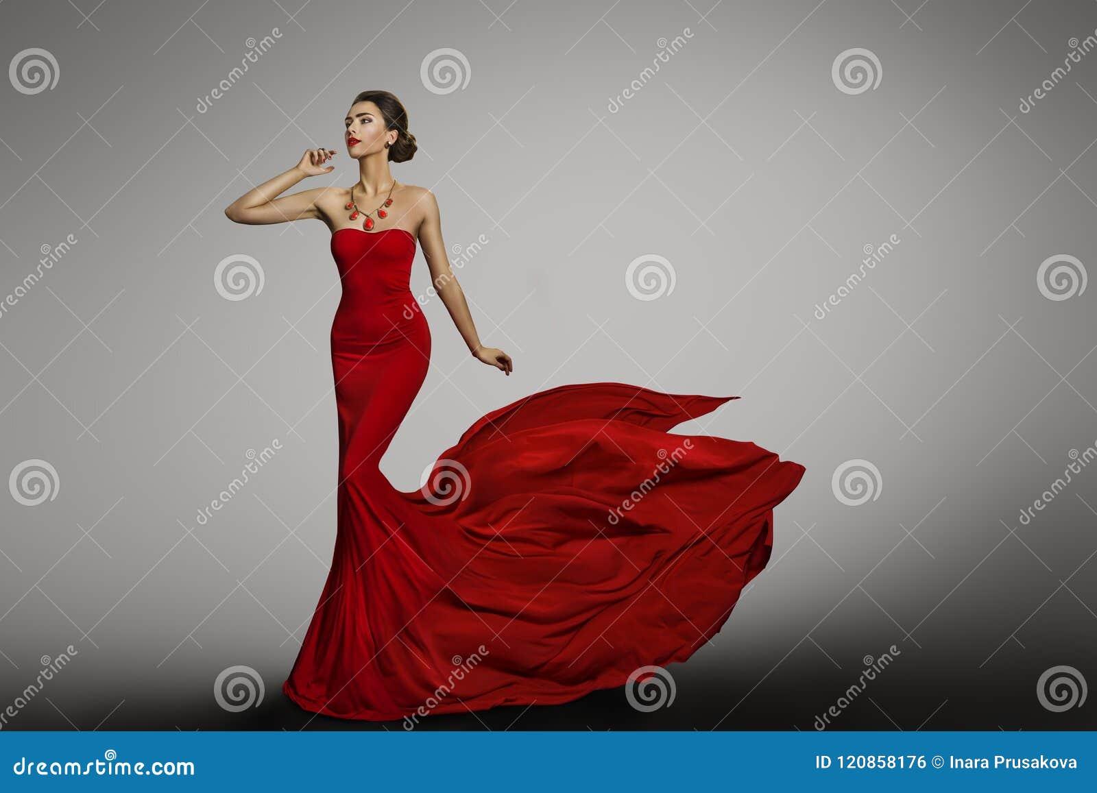 Κόκκινο φόρεμα γυναικών, πρότυπο μόδας στη μακριά κυματίζοντας προκλητική εσθήτα μεταξιού