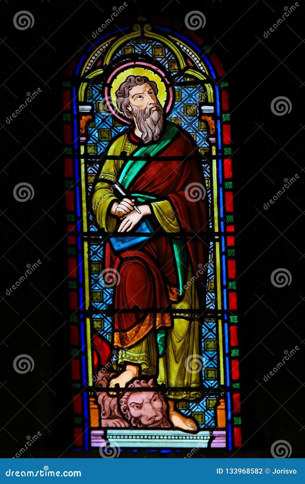 Λεκιασμένο γυαλί στον καθεδρικό ναό του Μονακό - σημάδι Αγίου ο Ευαγγελιστής