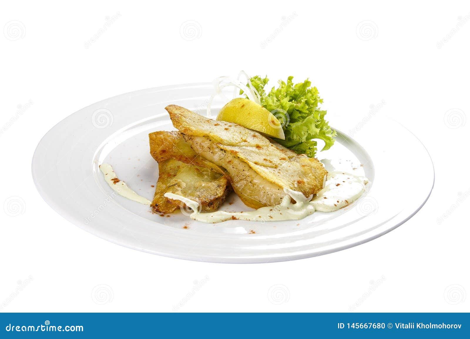 Λωρίδες βακαλάων με το λεμόνι και τη σαλάτα