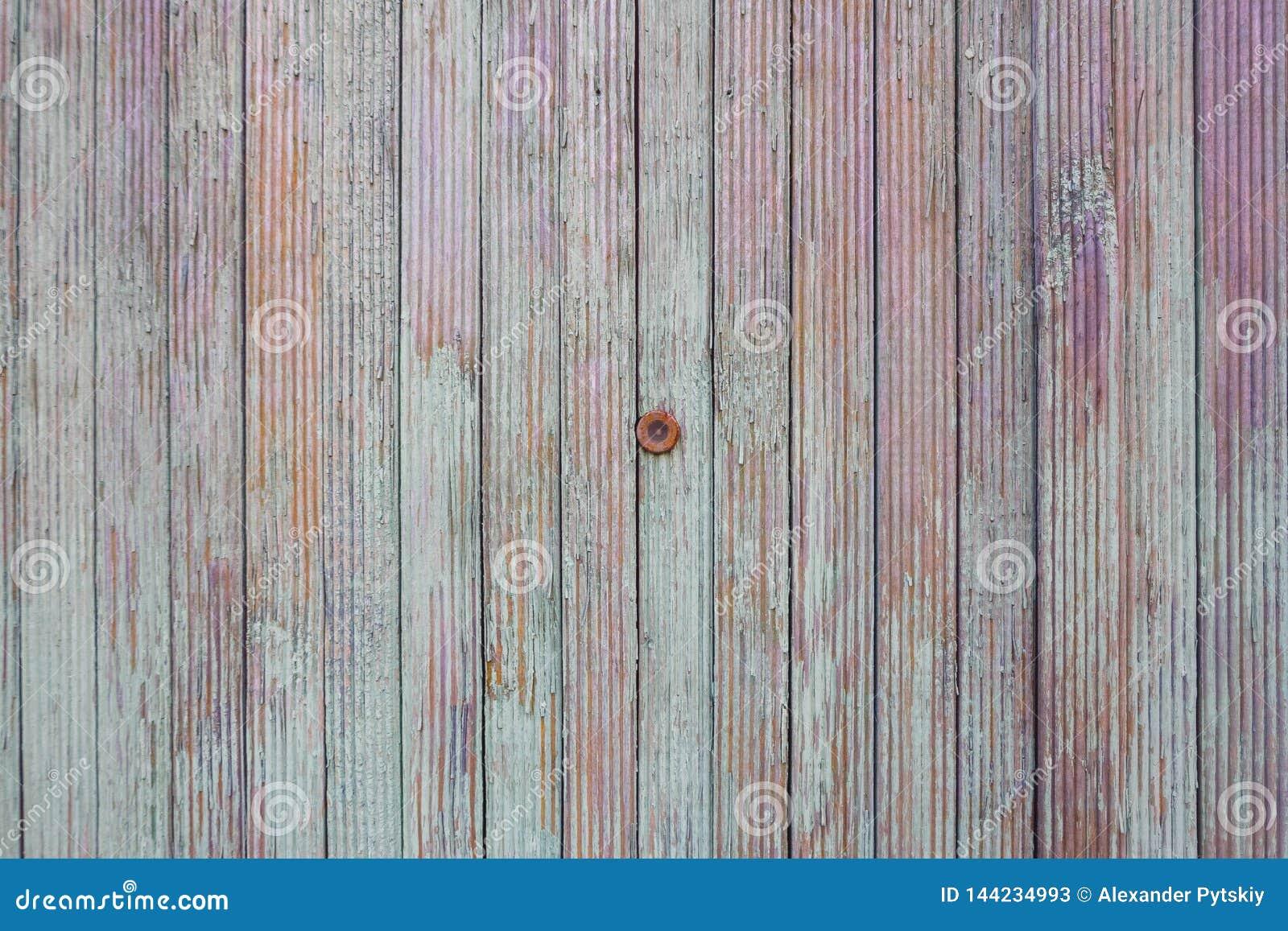 Ματάκι πόρτας στον παλαιό φράκτη χρώματος Η σύσταση των πινάκων του τυρκουάζ, της πορφύρας και του πορτοκαλιού