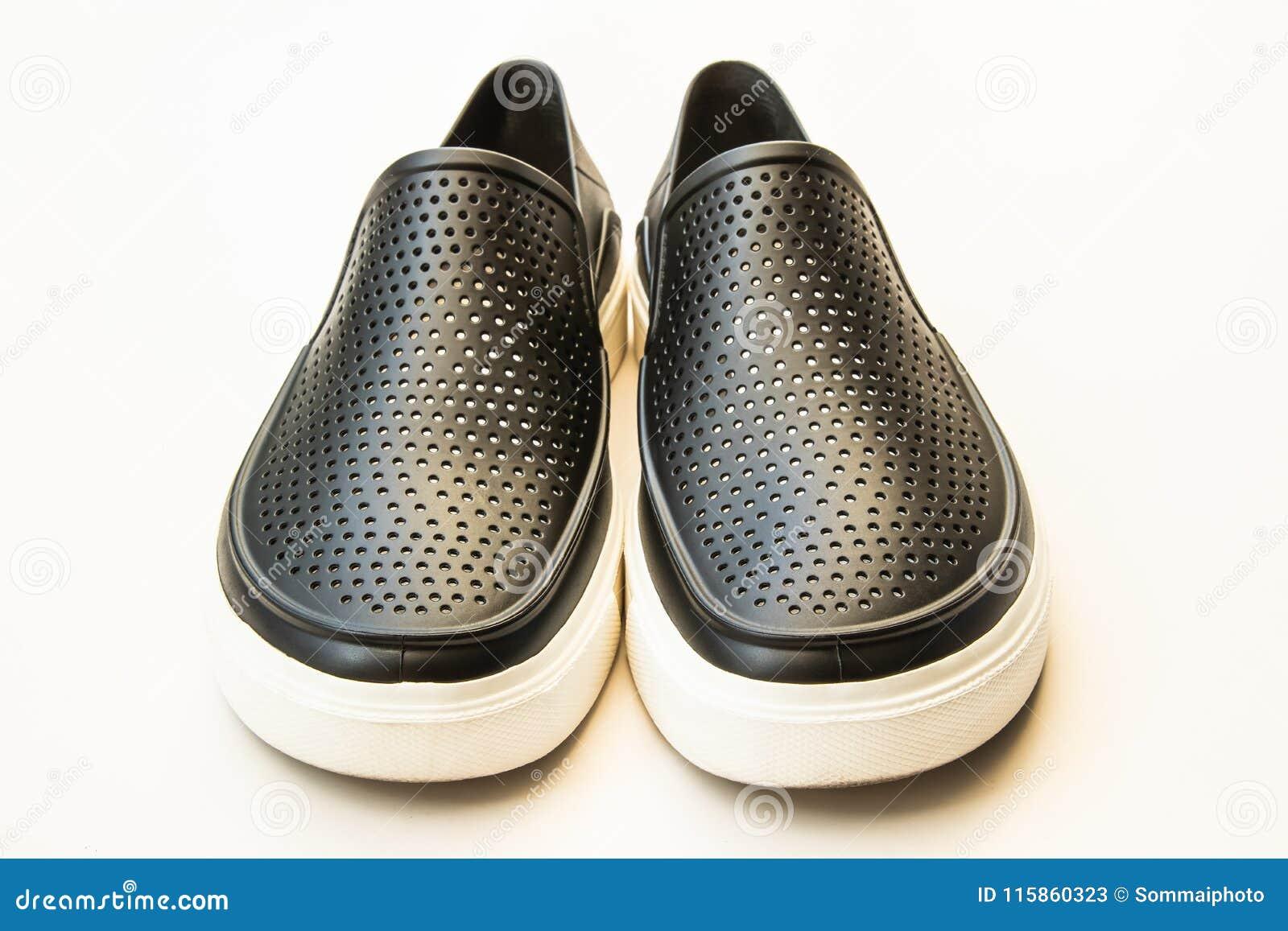 b519930baa9 Μαύρα λαστιχένια παπούτσια μόδας ατόμων ` s, περιστασιακό σχέδιο που  απομονώνεται στο λευκό