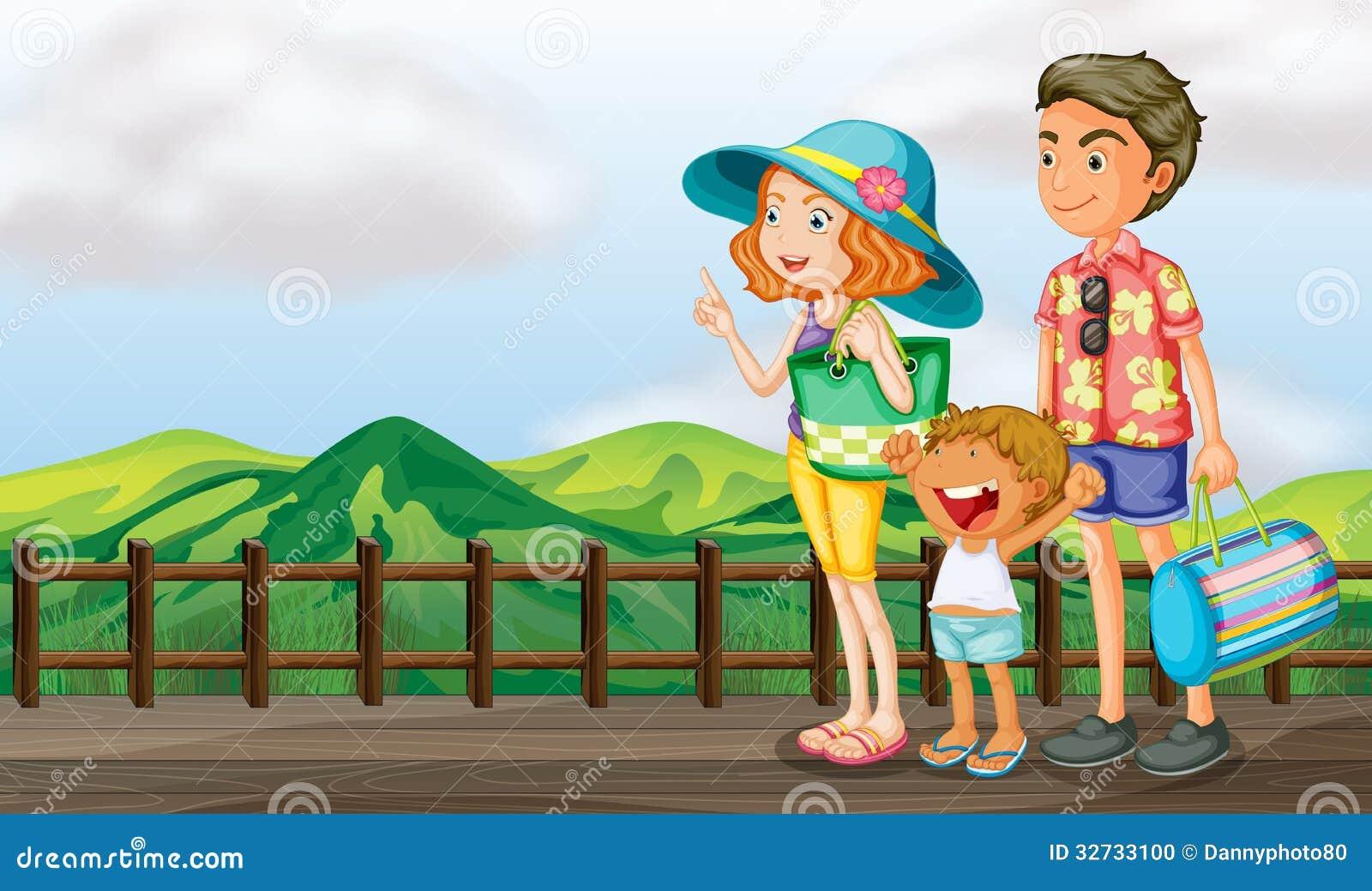 Μια ευτυχής οικογένεια στην ξύλινη γέφυρα