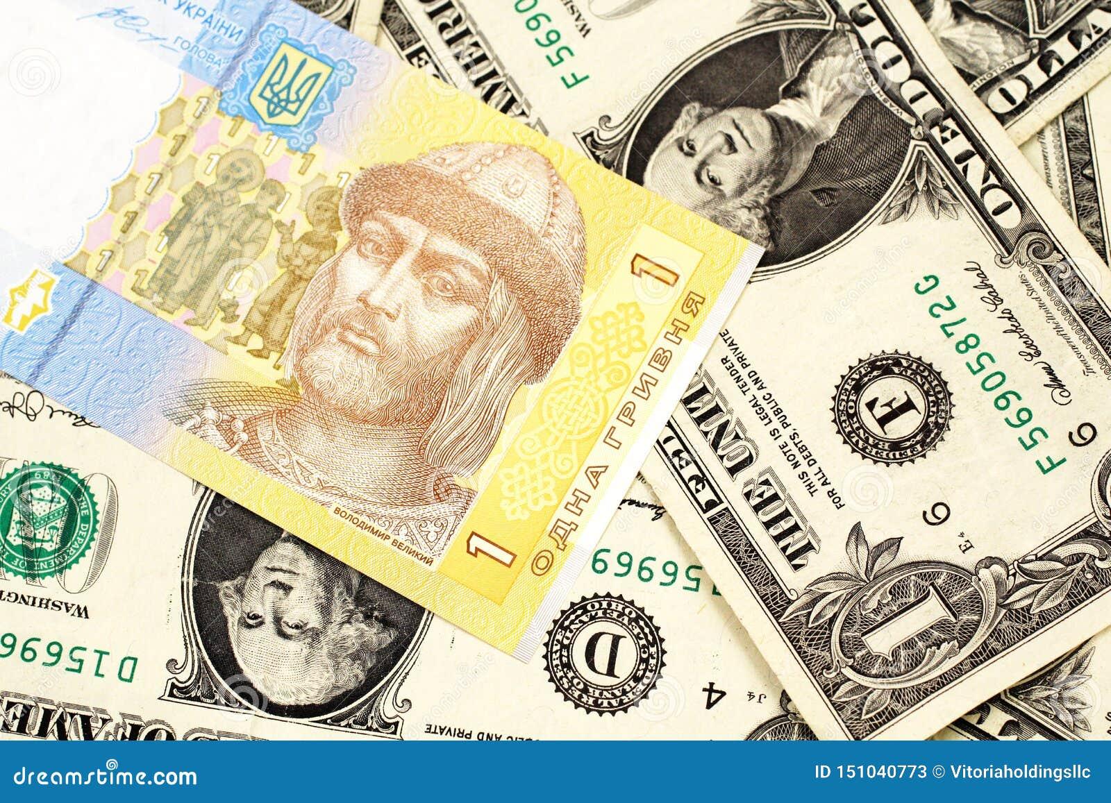 Μια ουκρανική σημείωση hryvnia με αμερικανική λογαριασμοί δολαρίων