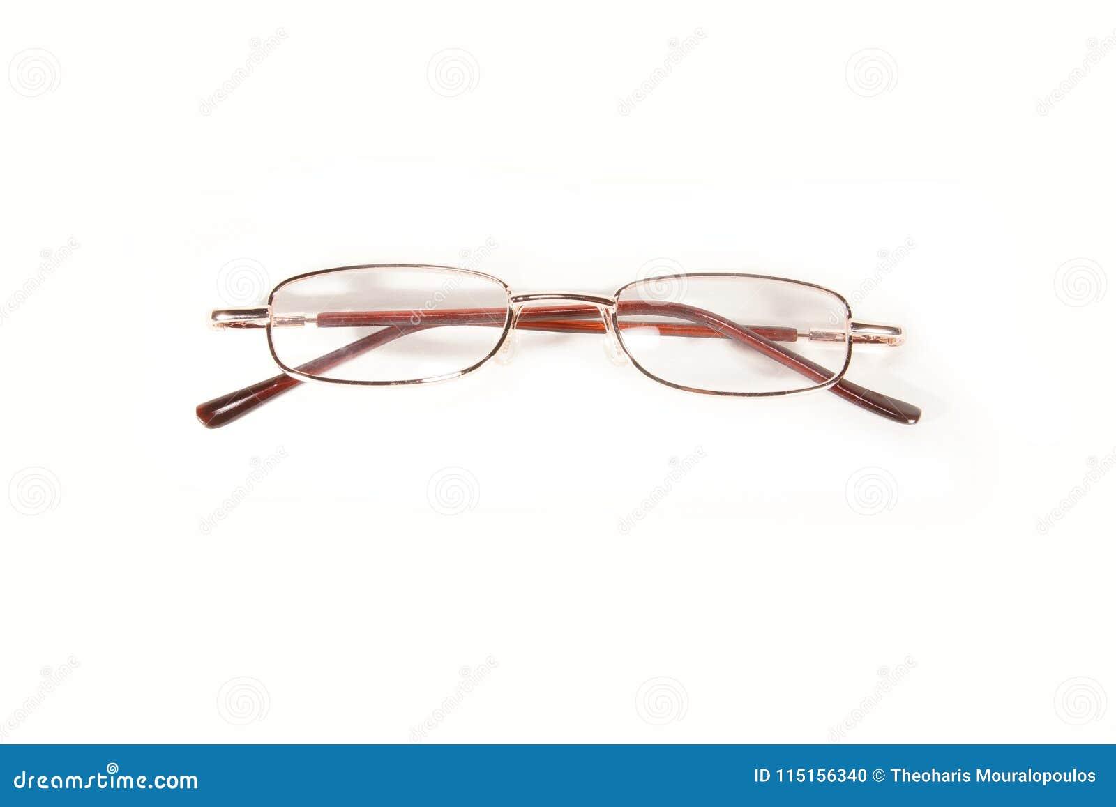 Μικρά μεταλλικά eyeglasses που απομονώνονται