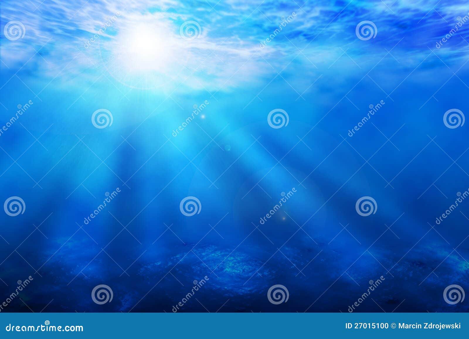 Μπλε ωκεάνια υποβρύχια ανασκόπηση ακτίνων ήλιων