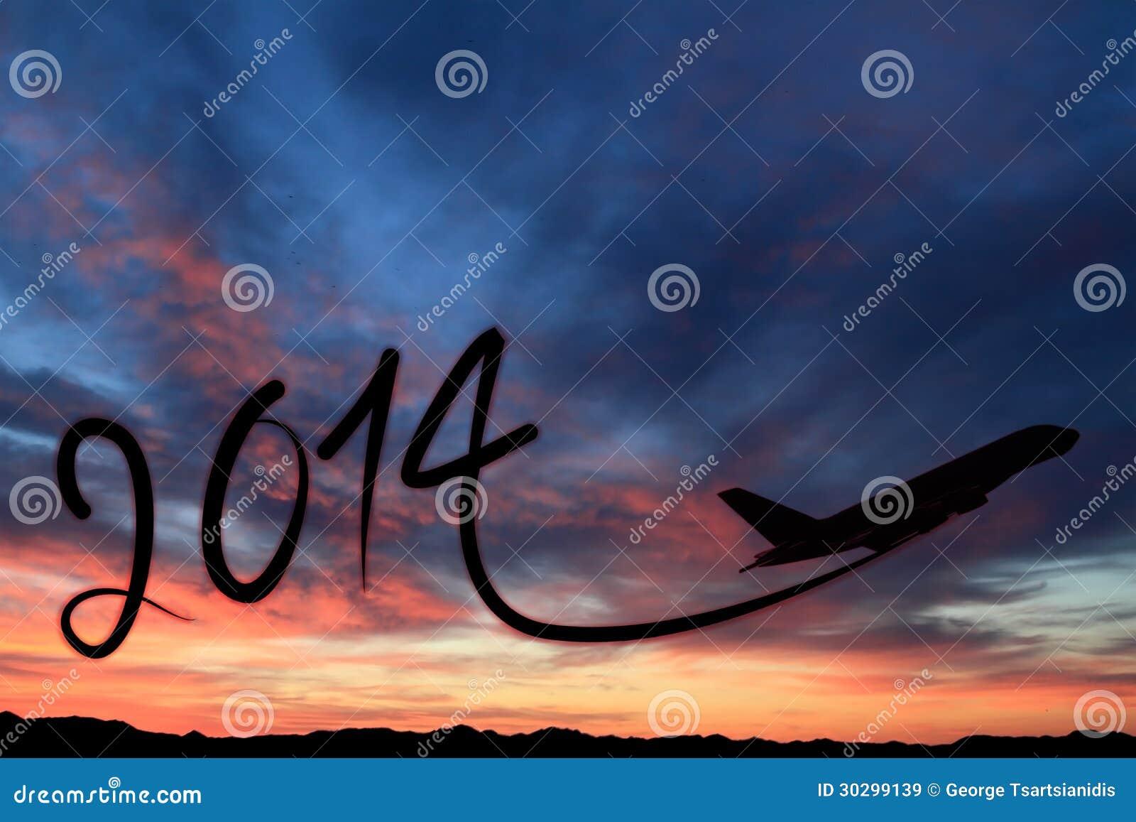Νέο έτος 2014 που επισύρει την προσοχή στον αέρα στο ηλιοβασίλεμα