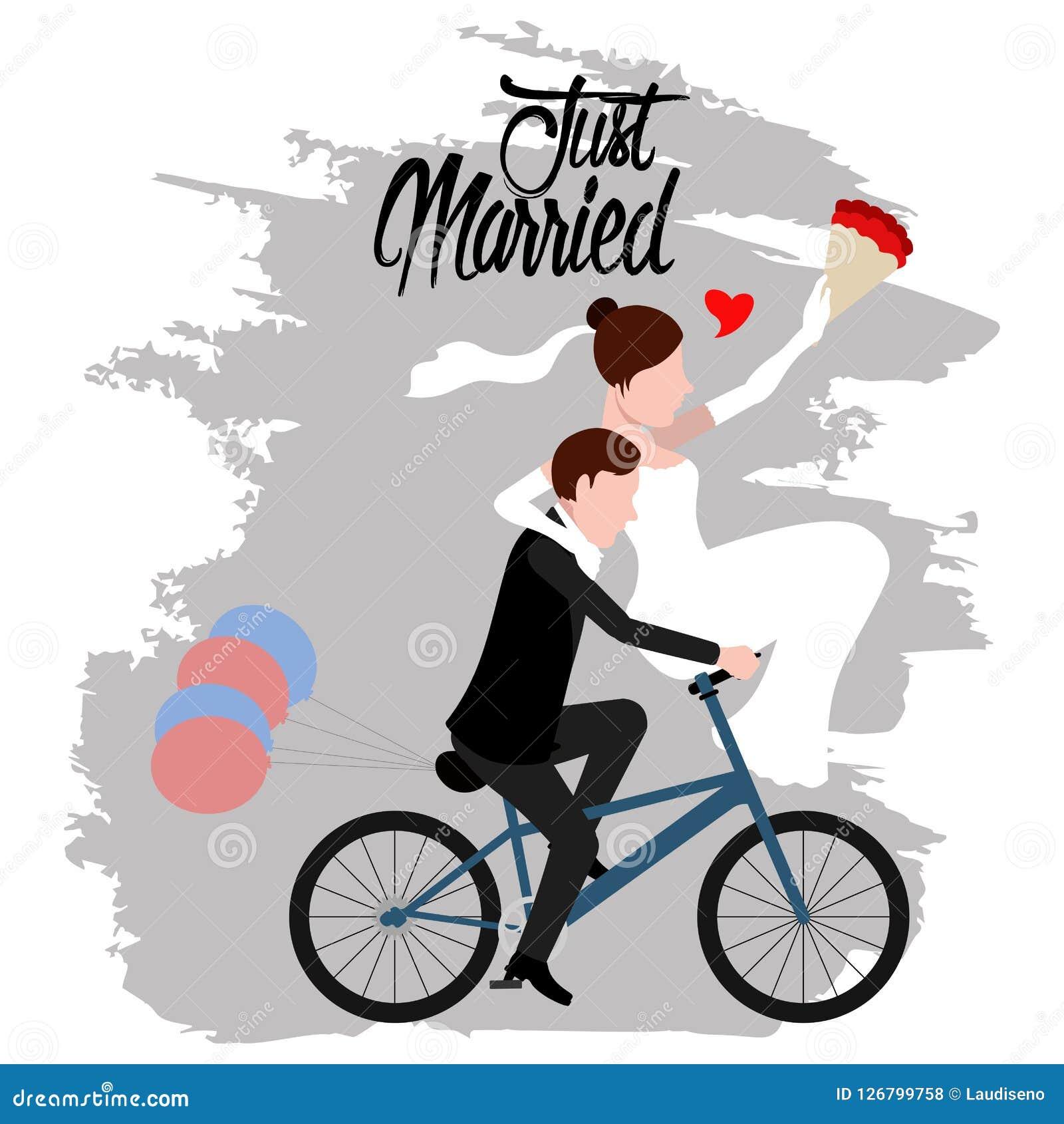 Νεόνυμφος και νύφη σε ένα ποδήλατο ζευγάρι ακριβώς παντρεμέν&o