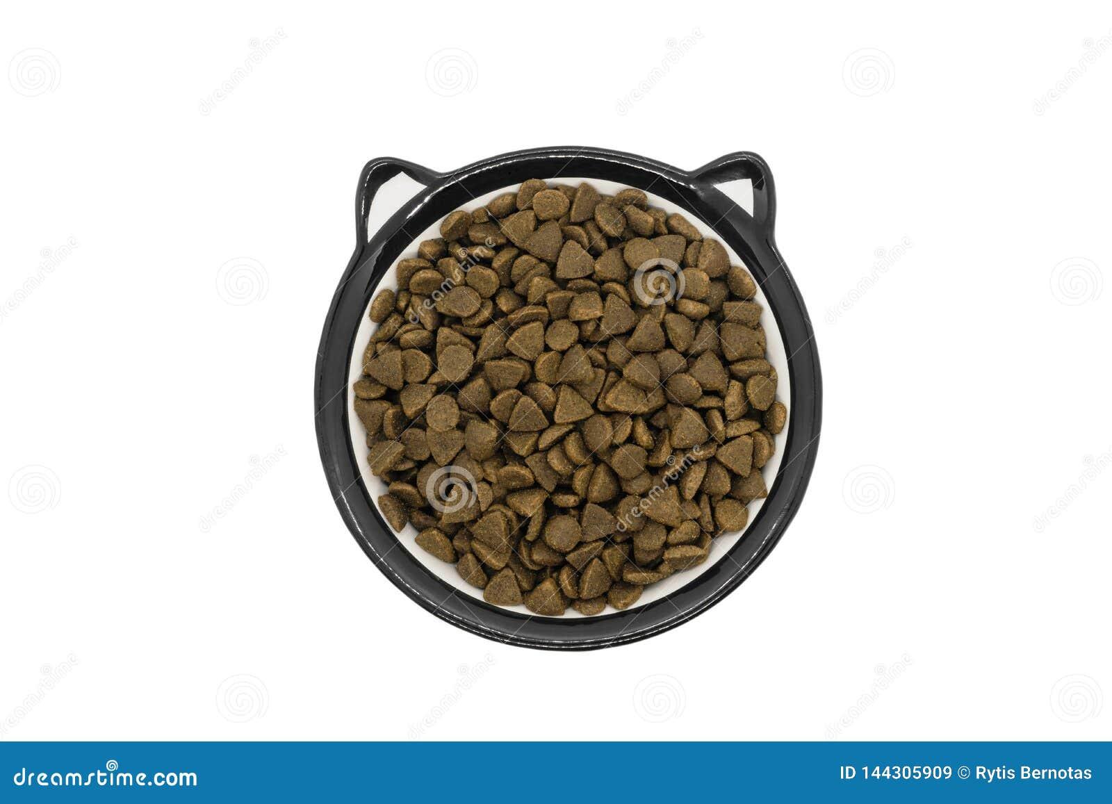 Ξηρά τρόφιμα γατών ή σκυλιών στο στρογγυλό κύπελλο