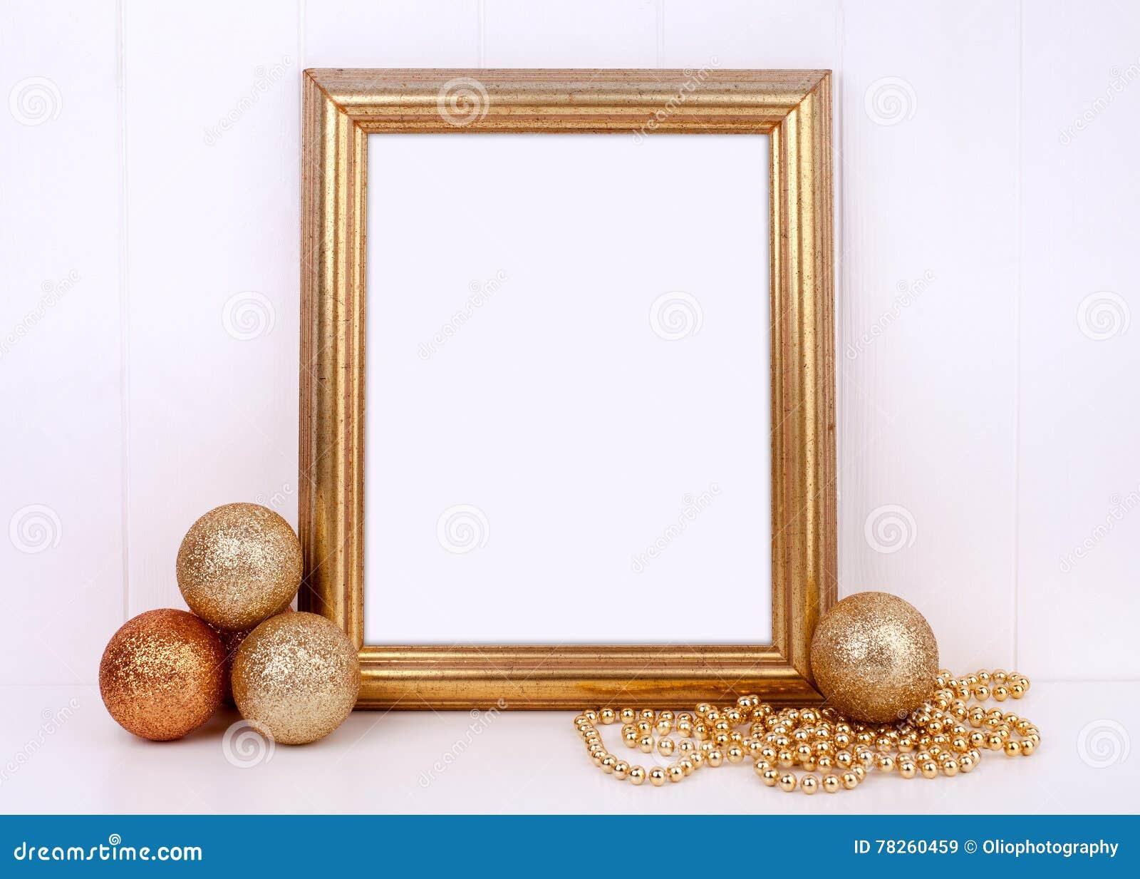 Ορισμένη φωτογραφία αποθεμάτων Χριστουγέννων πρότυπο με το χρυσό πλαίσιο