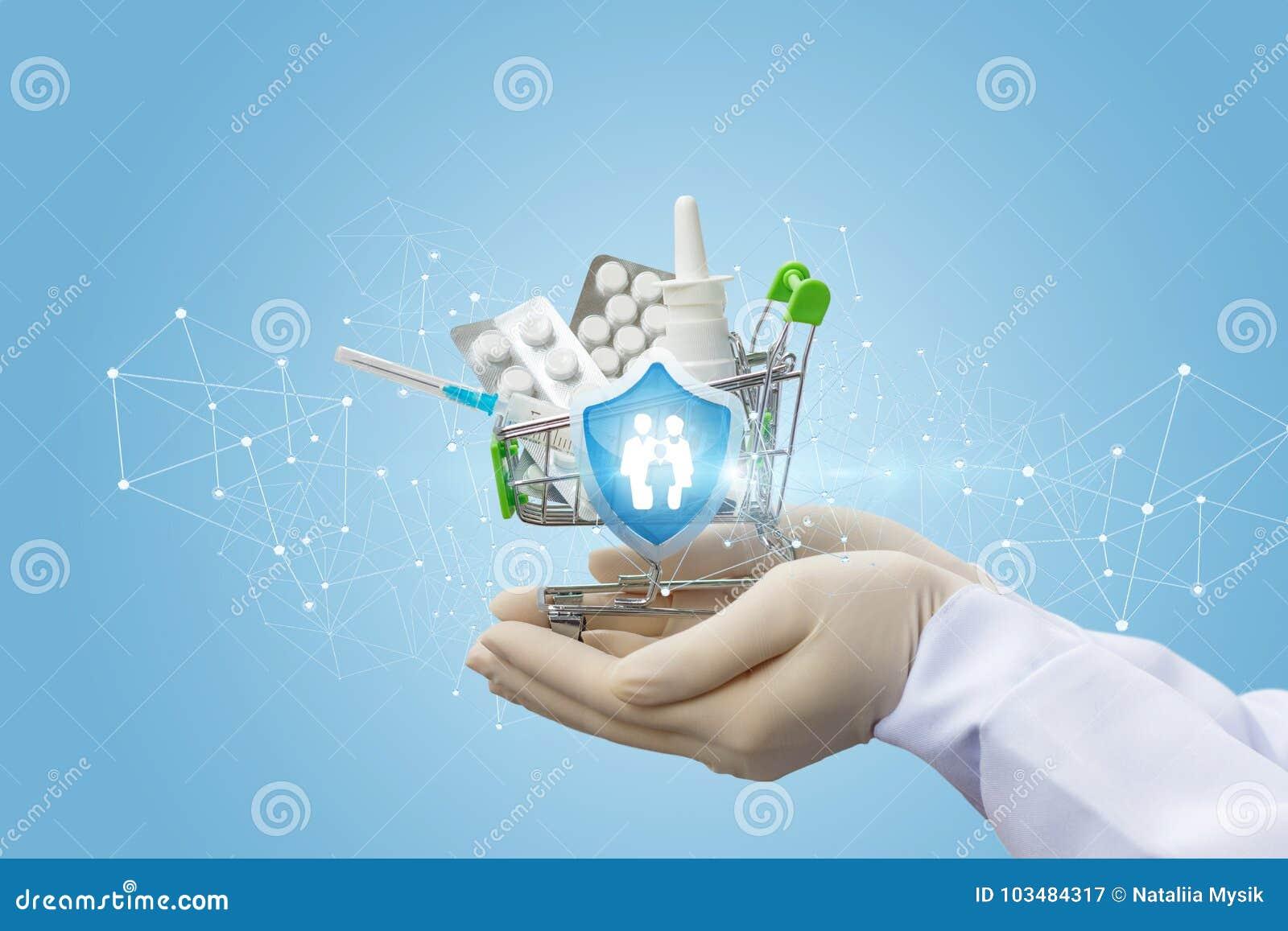 Ο γιατρός κρατά τα φάρμακα για την οικογενειακή προστασία