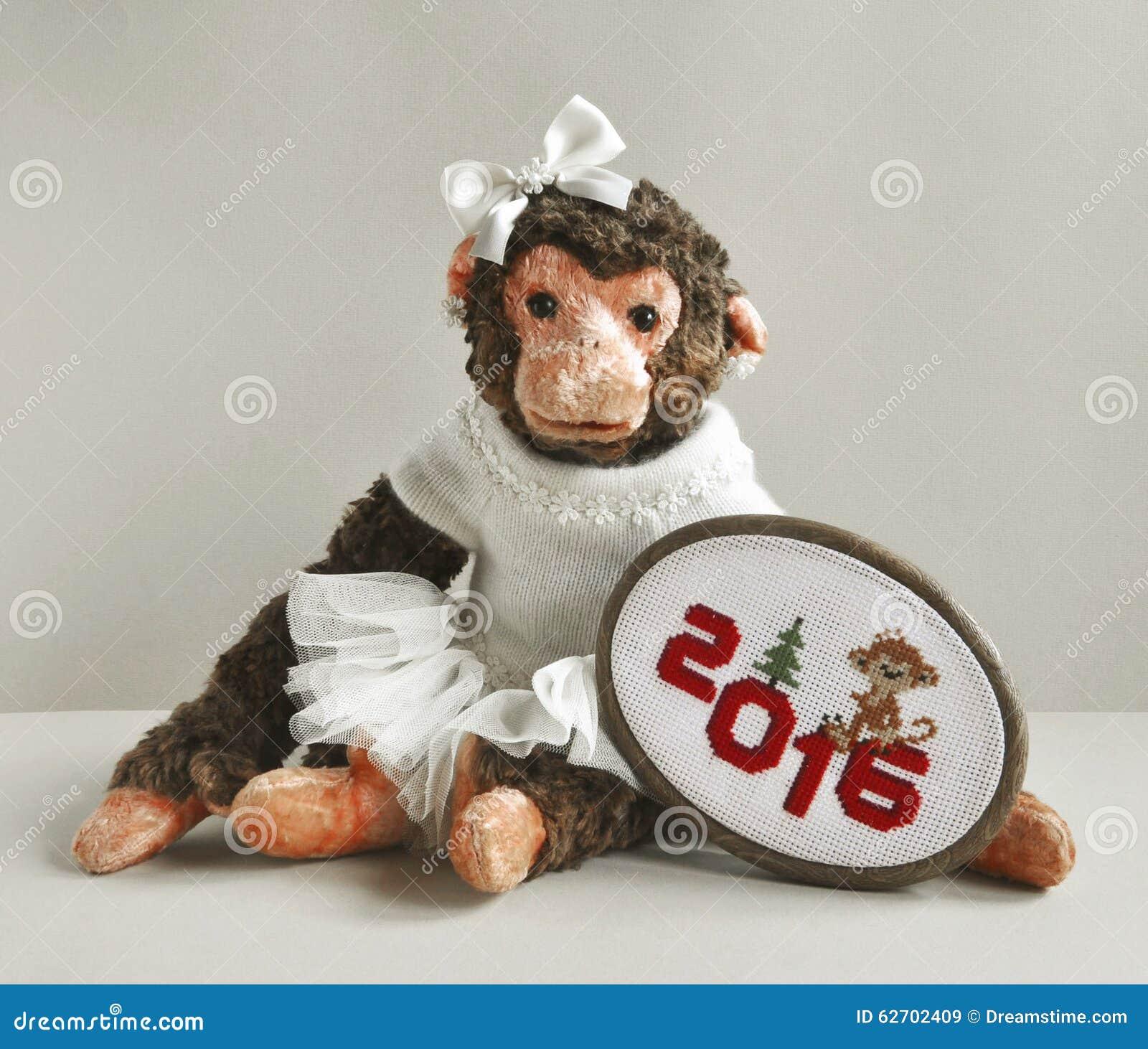 Πίθηκος παιχνιδιών με τη βελονιά κεντητικής
