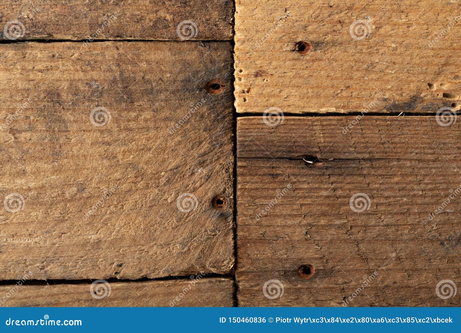 Πίνακας φιαγμένος από ξύλινες παλαιές σανίδες Μια επιφάνεια που καλύπτεται επίπεδη με το ξύλο